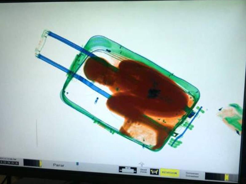 Father of 'suitcase boy' on smuggling trial in Spain