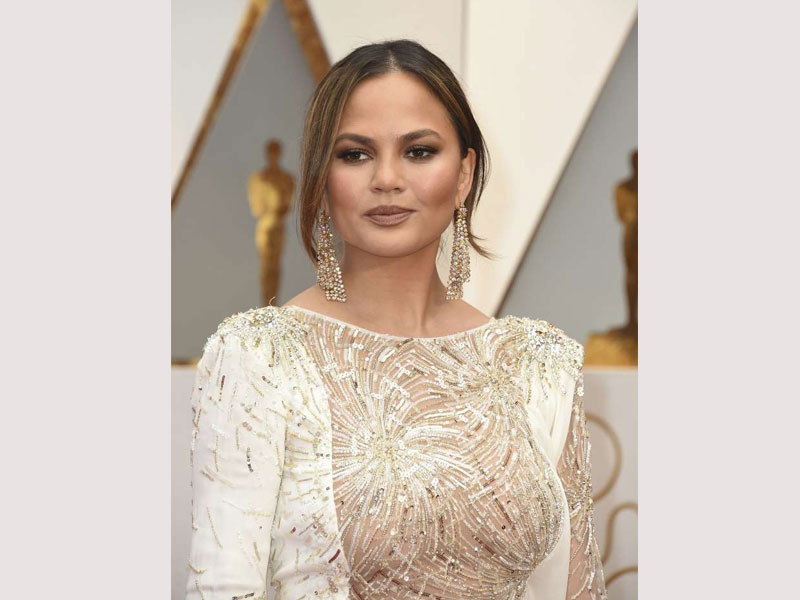 Pregnant Chrissy Teigen's All-Black Look Nods Beyoncé's 'Formation' Style