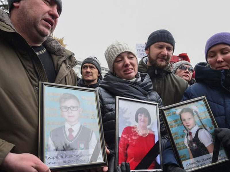 Russian Federation buries victims of mall blaze as flags fly at half mast