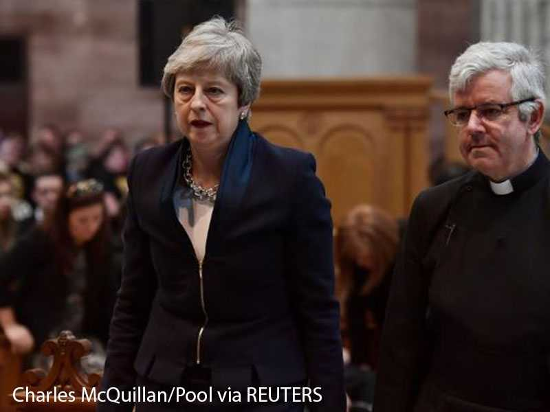 May resumes Brexit talks with opposition amid Conservative party revolt